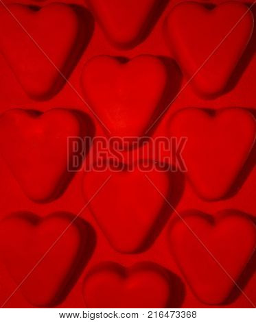 Red hearts texture. Red heart background. Seamless image with red flaring hearts. Concept of love.