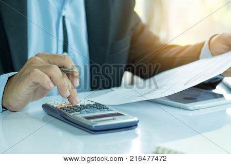 Business People Who Use A Calculator With Financial Concepts, Spreadsheet Data, Business People Use