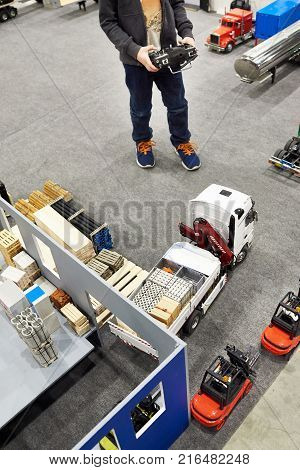 Boy Drives Truck Model With Radio Control Panel