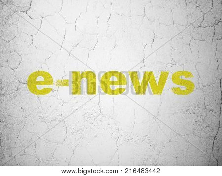News concept: Yellow E-news on textured concrete wall background