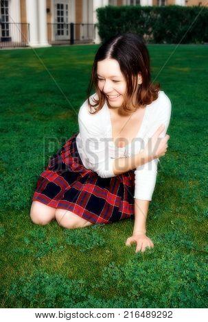 Soft focus of a lovely model female model posing outdoors