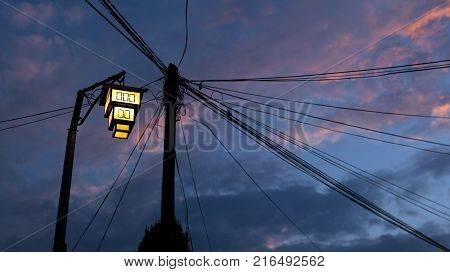 Street lamp in Ohrid, Republic of Macedonia. Messy wires on the background sunset time.