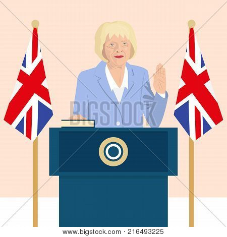 02.12.2017 Editorial illustration of the Prime Minister of the United Kingdom Theresa May that is taking an oath on Great Britain flag background.