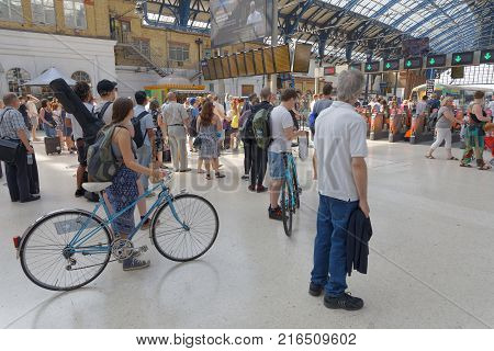 BRIGHTON GREAT BRITAIN - JUN 19 2017: People waiting for the train in the train station in Brighton UK. June 27 2017 in Brighton Great Britain