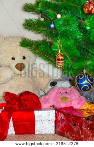 Gift Boxes Under Christmass Tree. Christmas And New Year Background. Winter Holidays Concept. Presen