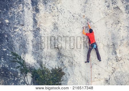 A Man Climbs The Rock.