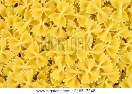 Farfale paste background, top view, yellow background