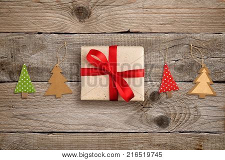 Gift box and christmas tree decorations on wooden table top view