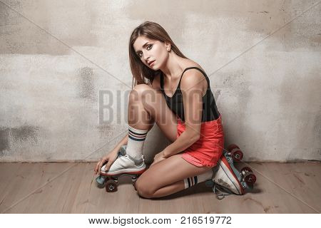 Beautiful Woman Wearing In Feet High Socks And Roller Skates.