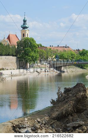 Raba River with Carmelite Church Next to the Raba River Bank in Gyor City