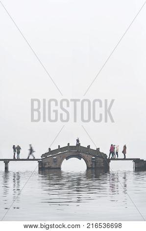 HANGZHOU, CHINA - JAN 5, 2013 - Busy bridge at West Lake, Hangzhou, China