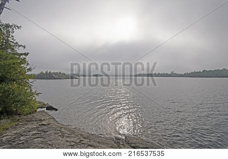 Sun Burning Through the Morning Fog on Little Saganaga Lake in the Boundary Waters of Minnesota
