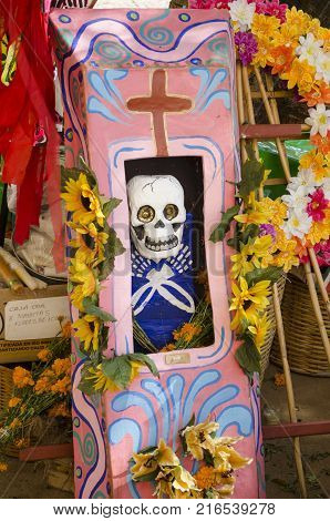OAXACA, OAXACA, MEXICO- NOVEMBER 1, 2017: Skeleton in a coffin, part of the mexican Day of the Dead celebration in Oaxaca, Mexico
