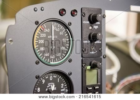 Aircraft dashboard macro. Airplane speedometer close up. Airspeed limits and flight safety.