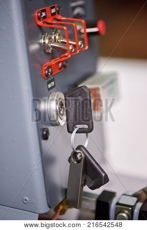 Airplane ignition key. Aircraft dashboard macro, switches. How to control a plane.
