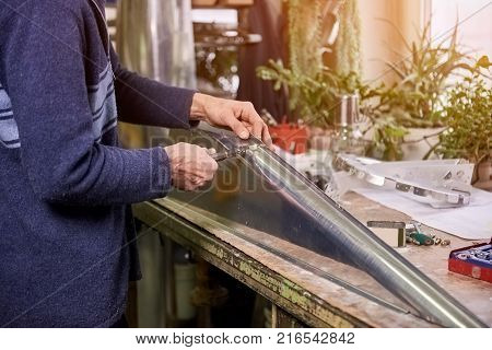 Man is installing a fastener. Man is installing a fastener in metal sheets.