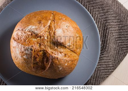 appetizing rye bread sprinkled with flour lies on a plate looks very appetizing