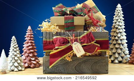 Large English style traditional Christmas hamper with paper wrapped gifts and food, close up.