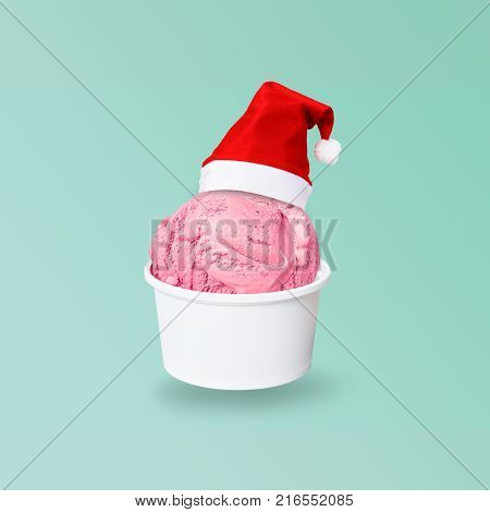 Santa Claus red hat on real soft serve chocolate ice cream in crispy wafer cone isolated on green background (Clipping path included) to celebrate Christmas holiday season new year party or special event