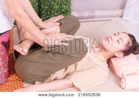 Woman is getting her leg push in Thai massage Therapy