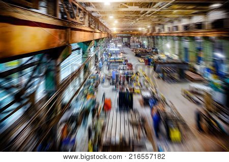 Factory shop, view from the top point. Abstract industrial background, motion blur effect.