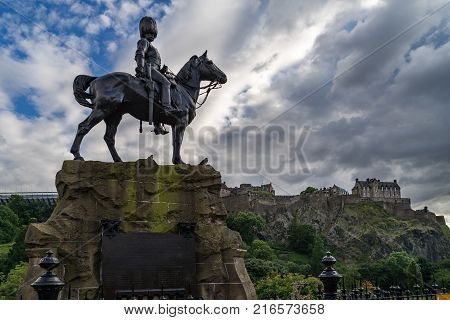 Royal Scots Greys Monument with Edinburgh Castle in the background from Princes Street