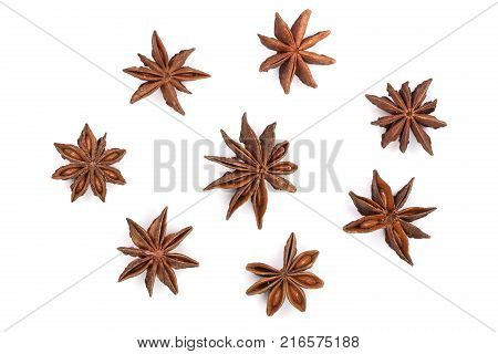 Star anise isolated on white background. Top view. Flat lay pattern.