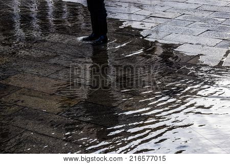 A rainy day with rain boots in Venice