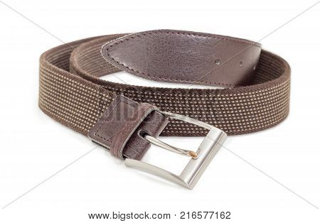 Casual brown elastic stretch belt for men with leather ends and classical buckle at shallow depth of field on a white background