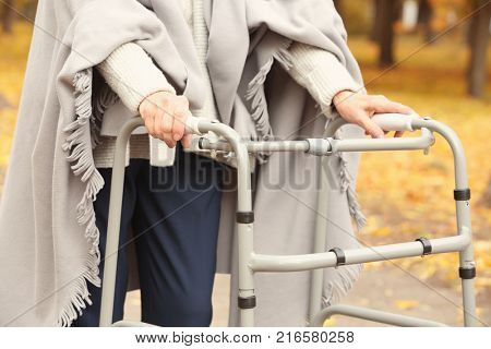 Senior woman with walking frame in park, closeup