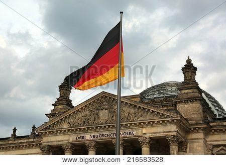 Berlin, Germany - August 18, 2017: Reichstag Building In Berlin With Flag. The Text Dem Deutschen Vo