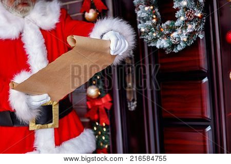 Santa wishes list- Santa Claus holding scroll paper