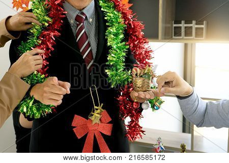 Work In Office Near Chrismas Time , Worker Feel To Relax For Their Holiday.