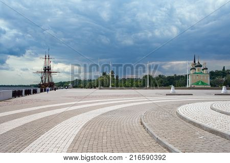 Voronezh Russia - June 11 2016: Admiralty Square - embankment of Voronezh storage reservoir with ship-museum and ancient Cathedral.