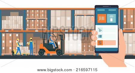 Warehousing and storage app on a smartphone goods and boxes on shelves in the warehouse and team of workers