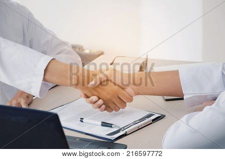business people handshake and clapping hand after finishing up a business meeting in office successful meeting partnership teamwork community connection concept vintage tone selective focus