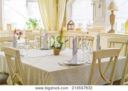 Elegant served table with wine glasses in modern restaurant