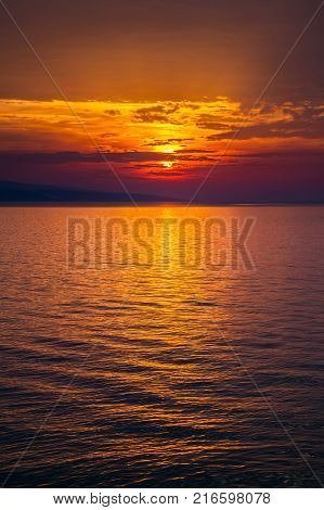 beautiful gold sunset with clouds over the Adriatic sea
