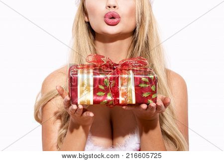 Blonde woman holding gift box and sending kisses isolated on white Christmas present