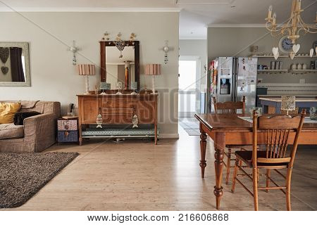 Interior of a modern residential home decorated with a country style dining table and hutch
