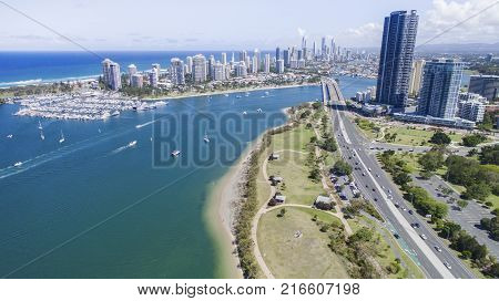 GOLD COAST, AUSTRALIA - NOVEMBER 26 2017: Aerial view over Broadwater Parklands. View south of Sundale bridge, Marina Mirage boat harbour and Surfers Paradise in the far distance.