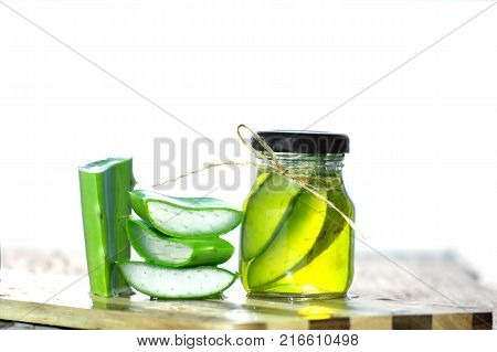Aloe Vera On a white background.fresh aloe vera leaves and glass of aloe vera juice on wooden background ต้นไม้ชนิ