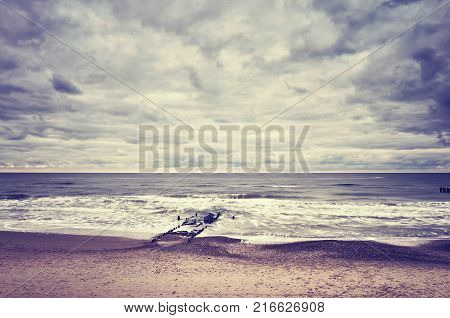 Color Toned Picture Of An Empty Beach With Blurred Water.