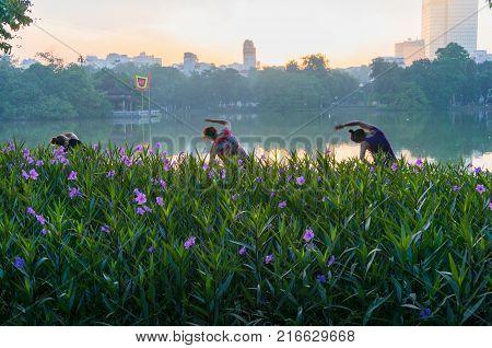 Hanoi Vietnam - August 21 2017: Three Women Doing Exercise On Hoan Kiem Lake In The Morning