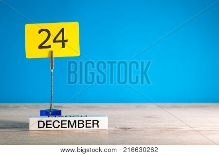 Christmas Eve. December 24th mockup. Day 24 of december month, calendar on blue background. Winter time. Empty space for text.