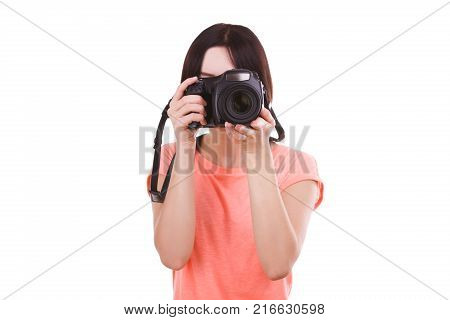 Young beautiful girl in pink t-shirt looks at camera on white isolated background. Front view