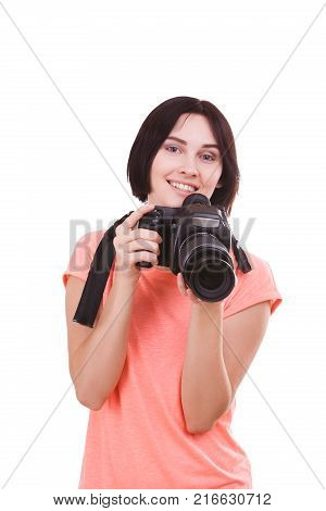 A young, beautiful girl in a pink t-shirt with a smile put the camera away from the face on a white isolated background