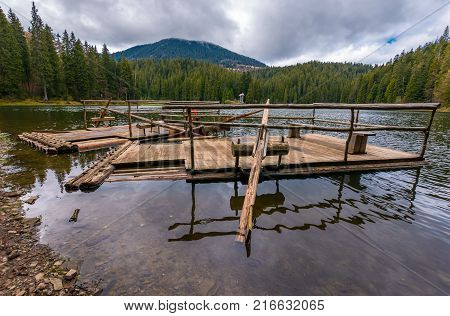 two wooden raft on the shore of Synevyr lake. Beautiful springtime nature scenery in the most visited location of Carpathian mountains