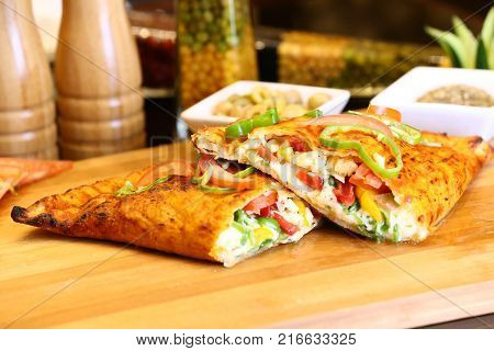 Sandwich-sized calzones are often sold at Italian lunch counters or by street vendors,