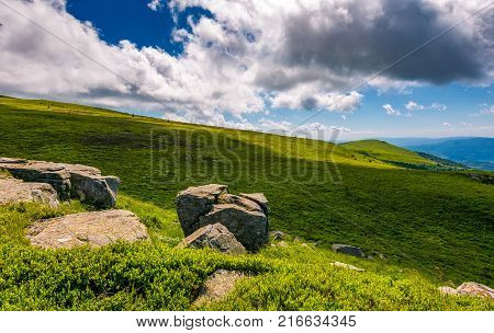 Grassy Slope With Huge Boulders